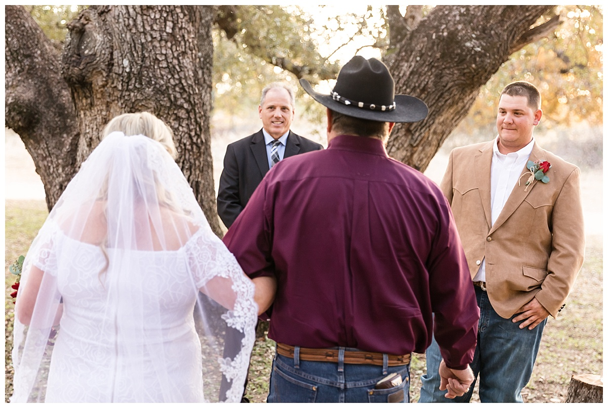 Wedding-Photographer-LaVernia-Texas-Ceremony-Under-the-Trees-Bride-Groom-Fall-McDonald-Carly-Barton-Photography_0027.jpg