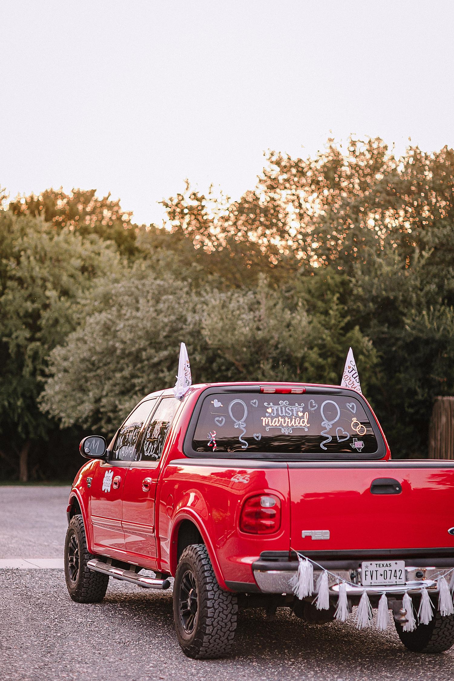 Carly-Barton-Photography-Old-Town-Texas-Rustic-Wedding-Photos-Sunflowers-Boots-Kyle-Texas_0094.jpg